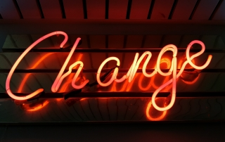 Neon sign says change